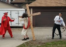 Bizarre Christian protest features a Pete Buttigieg impersonator flogging Jesus as Satan watches