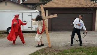 Bizarre Christian protest features a Pete Buttigieg impersonator flogging Jesus as Satan watches