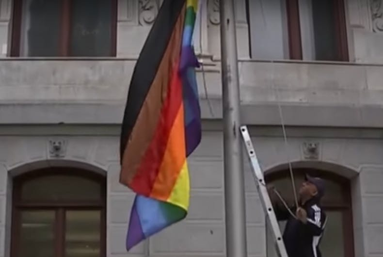 rainbow flag with brown and black stripes