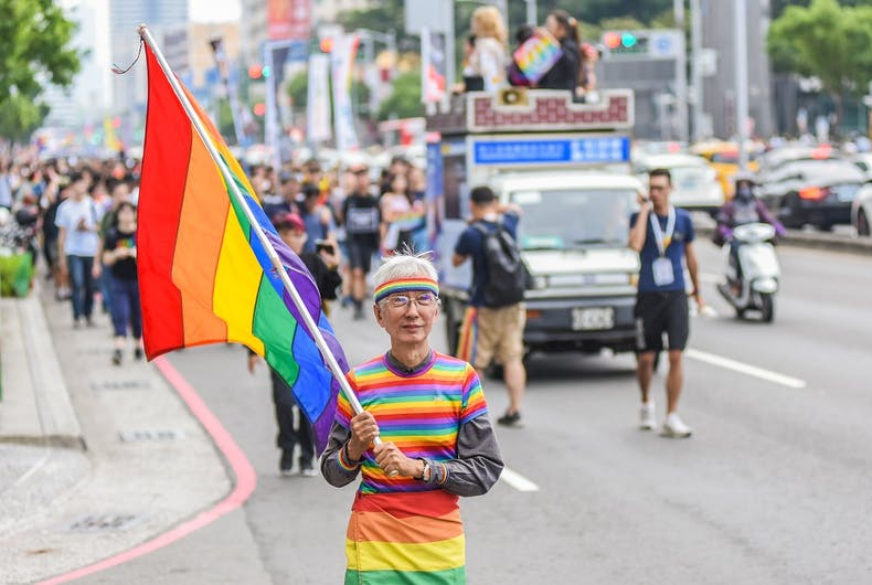 Kaohsiung, Taiwan-November 25, 2018: Chi Chia Wei, legendary protector of gay rights in Taiwan, marching with a rainbow suit in front of the LGBTQ Pride Parade.