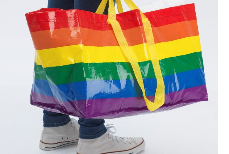 The rainbow Ikea bag, held by someone