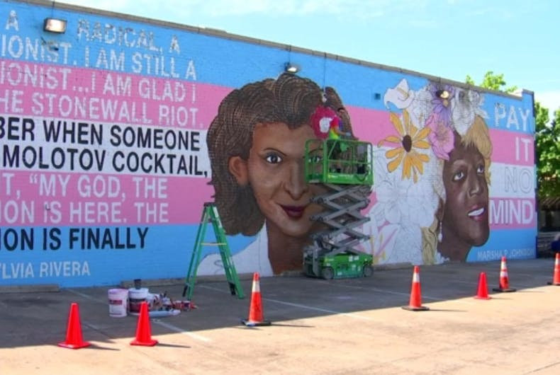 A new mural depicting the transgender pride flag along with portraits of Marsha P. Johnson and Sylvia Rivera is taking shape in a Dallas suburb.