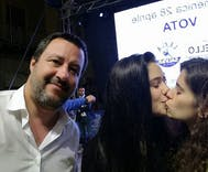 These women photobombed an anti-LGBTQ politician with a kiss
