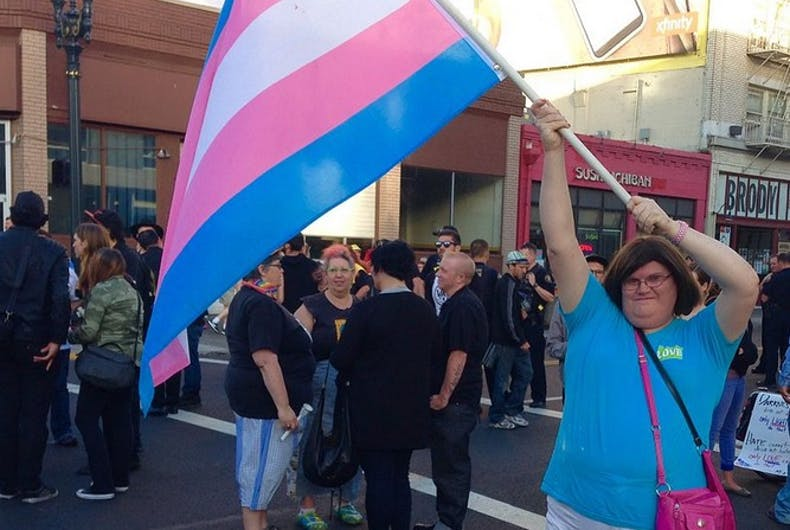 A demonstrator waving the transgender flag.