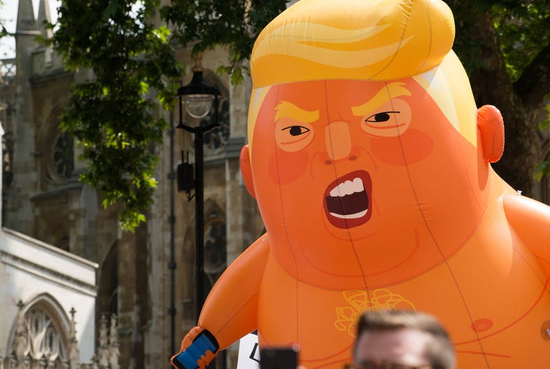 July 13, 2018: The orange Baby Trump blimp being paraded around Parliament Square, London, UK, at the #BringTheNoise Women's March demonstration.