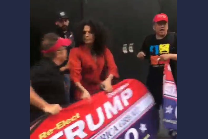 Indya Moore and the Trump supporter tugging the sign