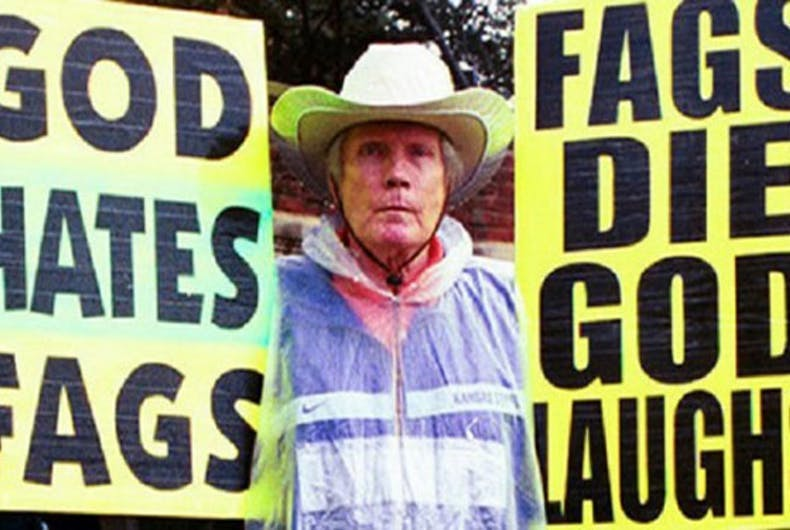 Westboro Baptist Church founder Fred Phelps holds his infamous signs