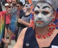 Watch these drag queens shut down a hate group supporter with synchronized fan thworps