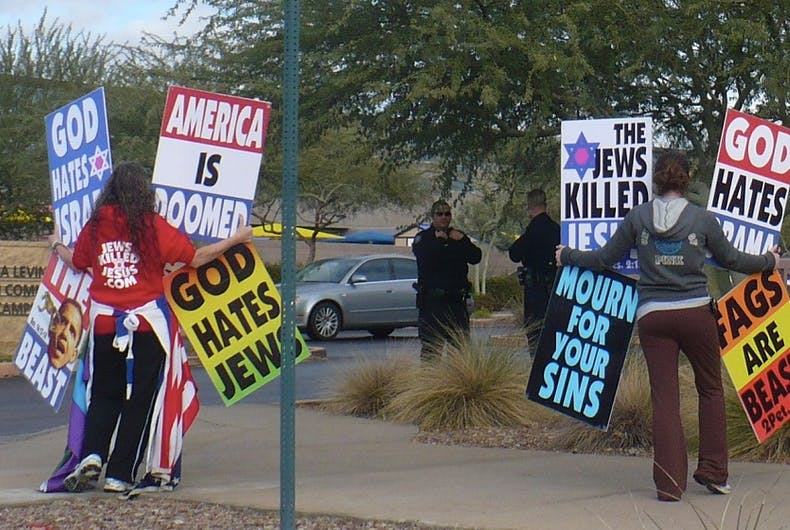Westboro Baptist Church protestors with their signs
