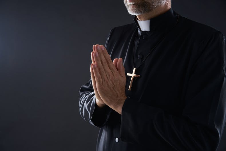 A dishy priest praying