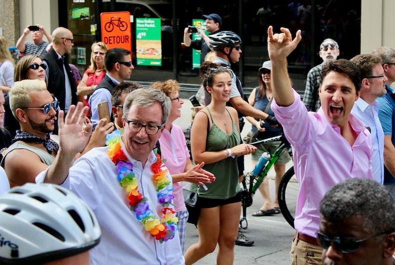 Mayor Jim Watson marches alongside Canadian Prime Minister Justin Trudeau at the 2017 Capital Pride Parade.
