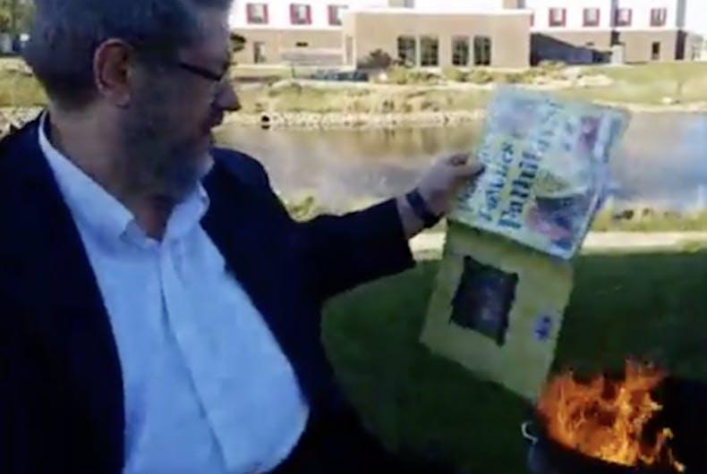 Paul Dorr burns a library book
