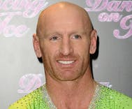 Rugby player Gareth Thomas comes out as HIV-positive after a tabloid threatened to out him