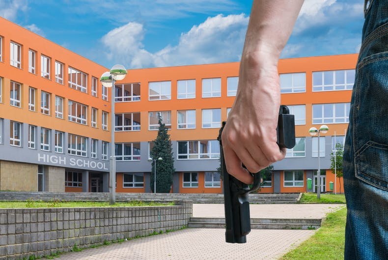 A stock image of a student with a gun