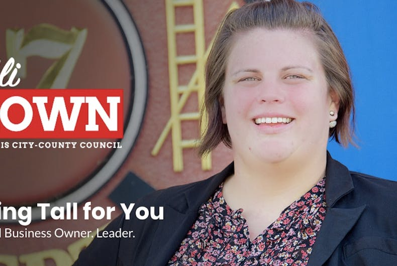 Ali Brown is a white woman with brown hair smiling on her campaign website