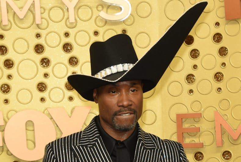 Billy Porter wears a hat with a wide upward-angles brim on the left side.