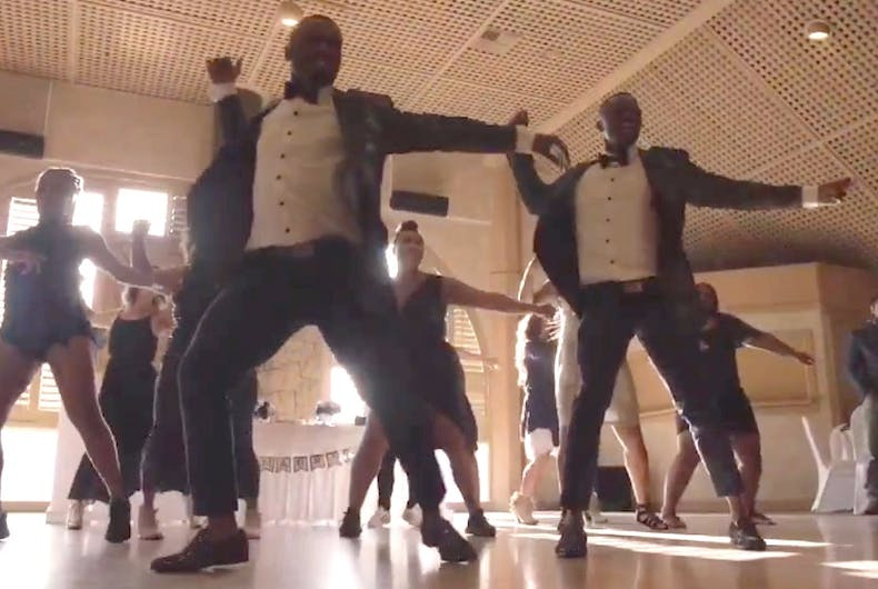 Isaiah Green-Jones and Tyler Green-Jones participate in a flash mob dance at their wedding.