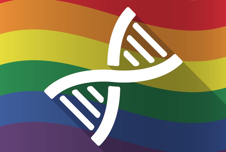 a DNA symbol sits on top of a pride flag