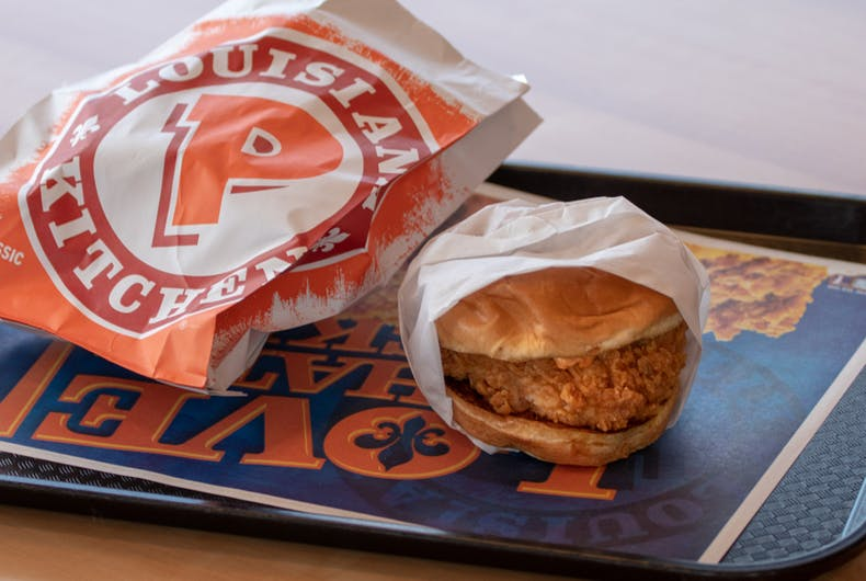 A spicy chicken sandwich from Popeyes fast food restaurant.