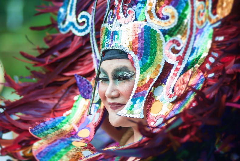 a performer wears a colorful sequin headdress at Sydney's Gay and Lesbian Mardi Gras