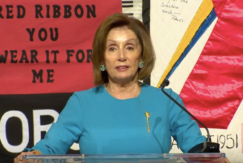 Democratic House Speaker Nancy Pelosi speaks in front of the AIDS Quilt during a November 20, 2019 announcement.