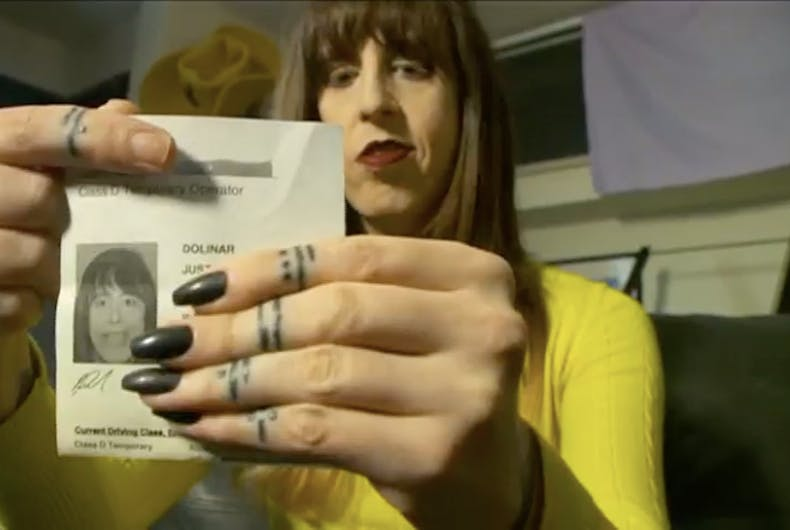 Jaydee Dolinar, a transgender woman in Utah, shows her temporary license.