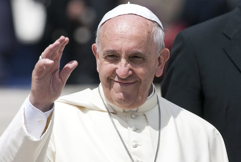 Pope Francis smiles and waves to his congregants.