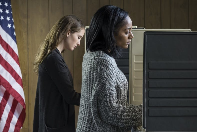 Two voters at a polling place