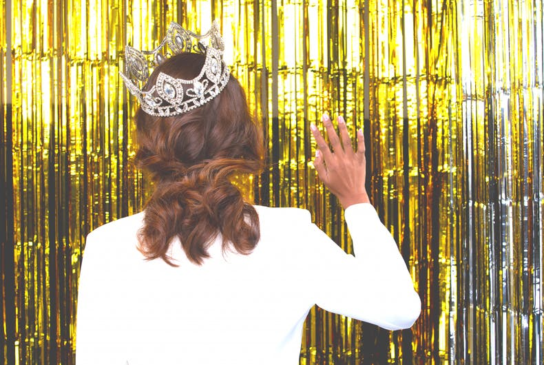 Portrait of Miss Pageant Beauty Contest in white blazzer dress with sparkle light Diamond Crown,