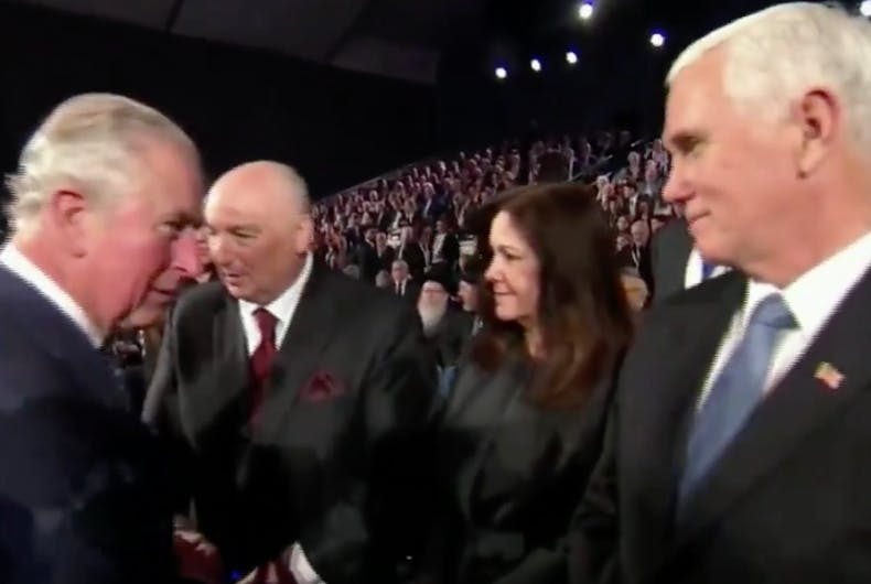 Prince Charles and Vice President Mike Pence stare at each other before separating without any greeting between them