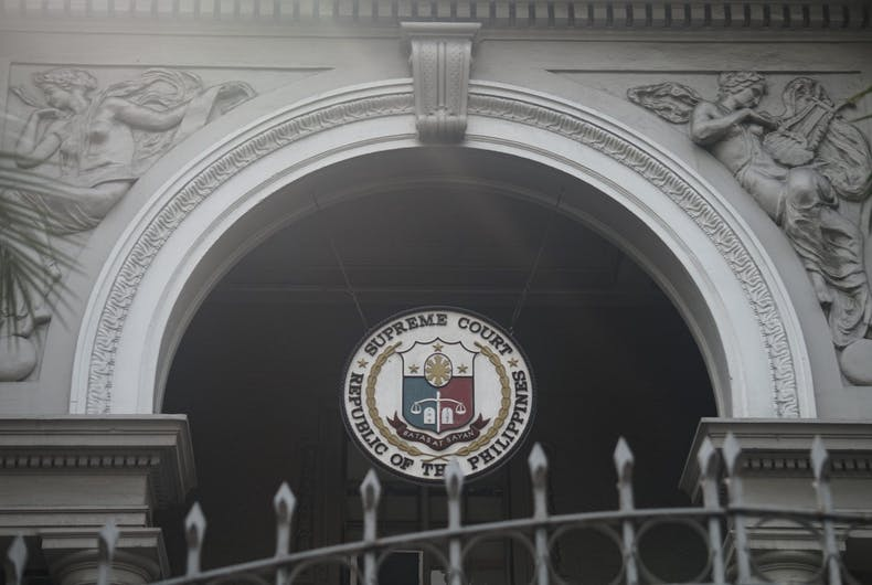 Manila, Philippines; February 6, 2018: An arched entrance in the old Supreme Court Building found along Taft Avenue. Bas relief figures of muses adorn each side.