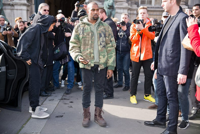 PARIS-MARCH 4, 2015. Kanye West posing for photographers in front of the Dries van Noten fashion show.