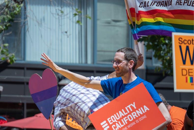 SAN FRANCISCO, CA JUNE 24, 2018: California State Senator Scott Weiner waves to the crowd at the 2018 San Francisco Pride Parade