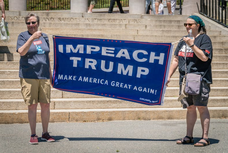 June 15, 2019: Citizens protest to impeach President Donald Trump at a rally held in front of the state capital building in Boston, MA.