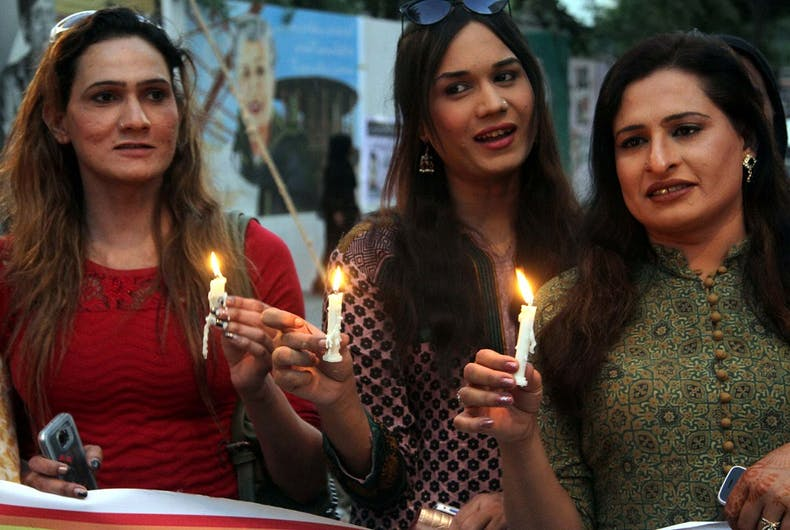 Transgender women in Pakistan holding candles