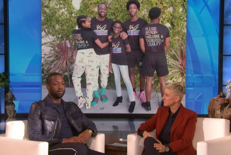 Dwyane Wade on Ellen's show in front of a photo of his family at Pride.