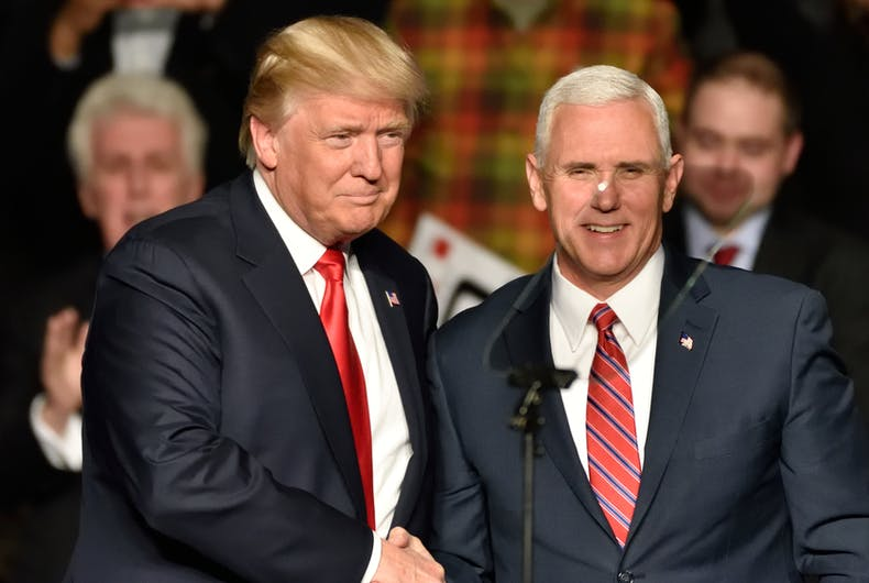 Donald Trump shakes Mike Pence's hand, and has also named him in charge of handling a possible Coronavirus outbreak in the U.S.