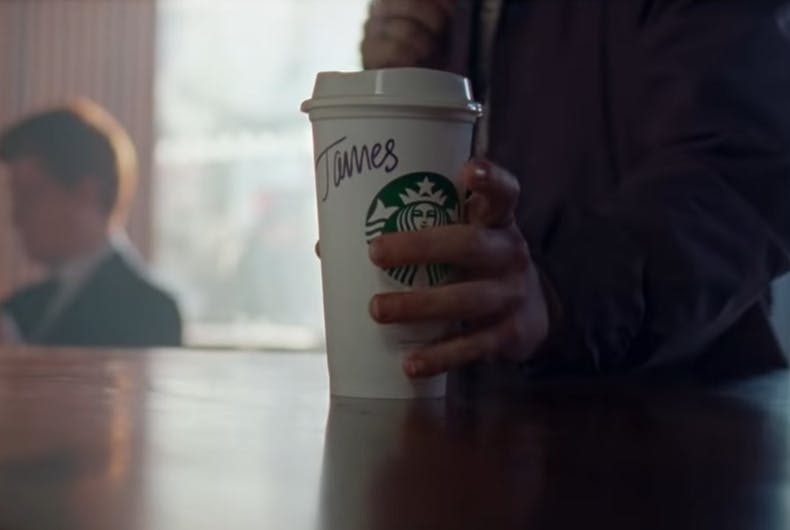 James grabs the Starbucks cup with his name on it