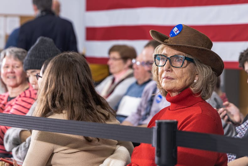 2/4/20 Concord, NH: A female voter waits for Democratic candidate Joe Biden to start a campaign speech at The International Brotherhood of Electrical Workers