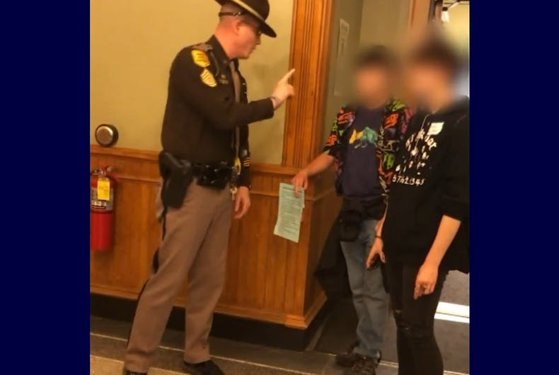A state trooper berating trans teens for using the appropriate restroom.