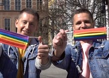 Gay couple hands out free rainbow facemasks in Poland to fight coronavirus & anti-LGBTQ sentiment