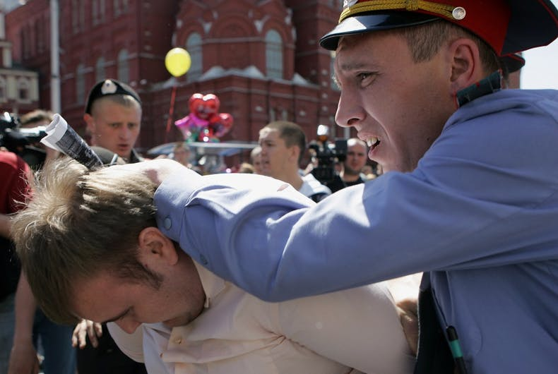Russian police detain a gay rights activist during an attempt to hold the unauthorized gay pride parade on May 28, 2011 in Moscow