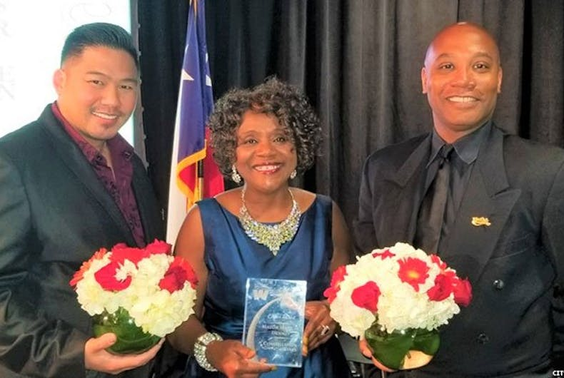 Phillip and Anthony Tsai-Brooks with Live Oaks, Texas Mayor Mary Dennis.