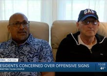 These men have to look at vile anti-LGBTQ signs every time they walk out the door