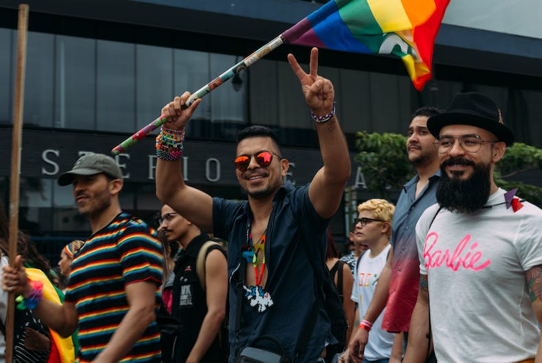 San Jose, Costa Rica 7/1/18: Unidentified participants waving flag in gay pride parade