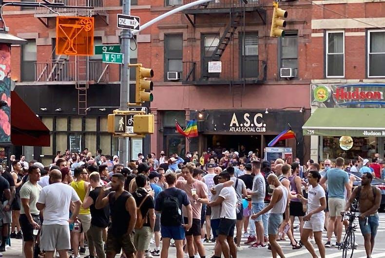 Gay men in Hells Kitchen not wearing masks during the coronavirus epidemic.