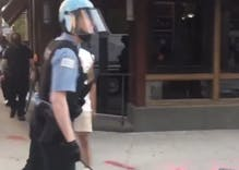 "Police officer caught on video calling a protestor a ""fa***t"""