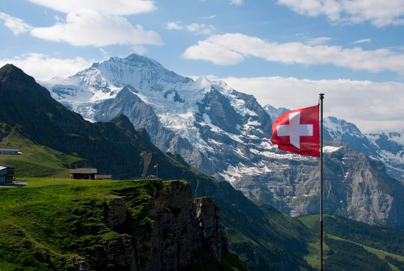 Swiss flag and mountains