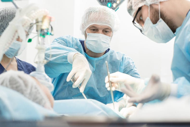 "Surgeon suspended after repeatedly calling sedated gay patient a ""fa***"" during operation"