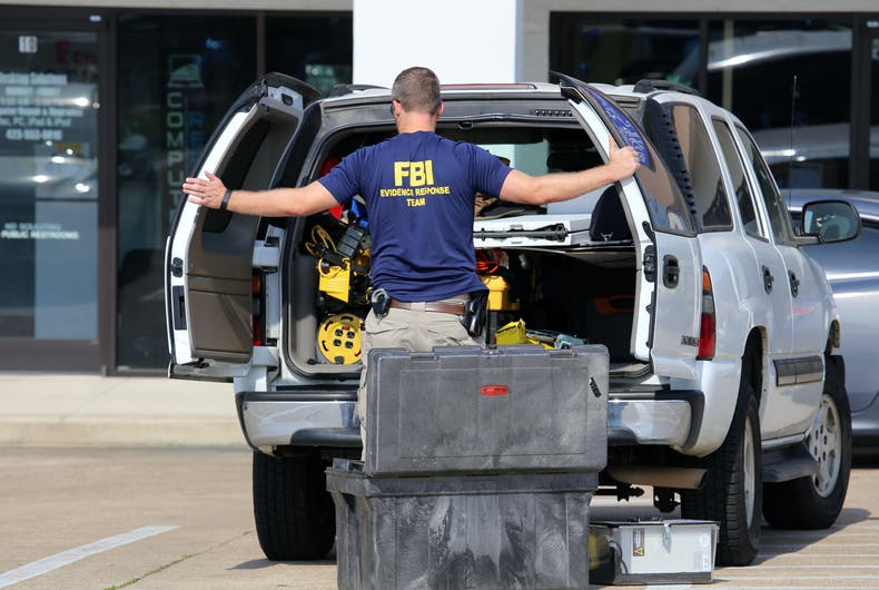An FBI agent gathers evidence at the Armed Forces Career Center in Chattanooga, TN on July 18, 2015. An attack on the center was carried out on July 16th, 2015.